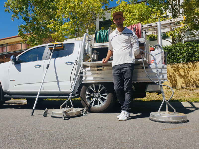 Roof cleaner and his equipment on the Gold Coast